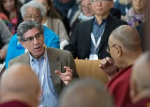 An image shows prominent American psychologist Richard Davidson talking with His Holiness the 14th Dalai Lama during day one of the 2018 Mind and Life Dialogue.