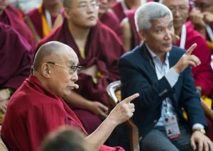 An image shows the English translator for the 14th Dalai Lama, Thupten Jinpa, speaking with His Holiness during day three of the 2018 Mind and Life Dialogue.