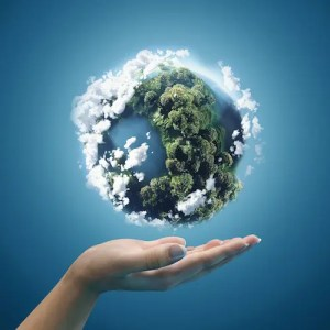 An computer generated image shows a woman's hand with a 3D globe floating above it. This image represents the idea that with integrity and intelligent effort, we can change the world.