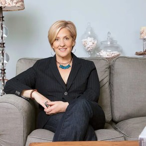 An image shows the prolific self-help author, inspirational speaker and distinguished researcher professor Brene Brown sitting confidently on a couch.