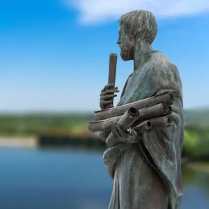 An image shows a statue of the immortalized Greek philosopher Aristotle.