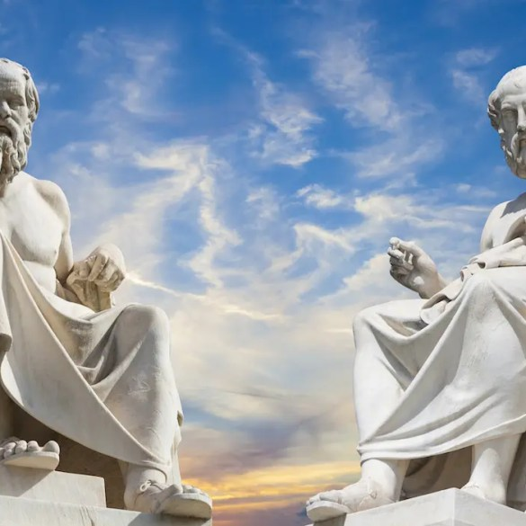An image shows statues of the iconic Greek philosophers Plato and Socrates sitting side by side. This picture is used as the featured image for Balanced Achievement's article titled 'Why The Great Philosophers Sought Self-Mastery & Inner Peace Over All Worldly Aspirations.'