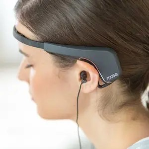 An image shows a woman using the Muse headband which is featured in Balanced Achievement's article on meditation tools of the digital age.