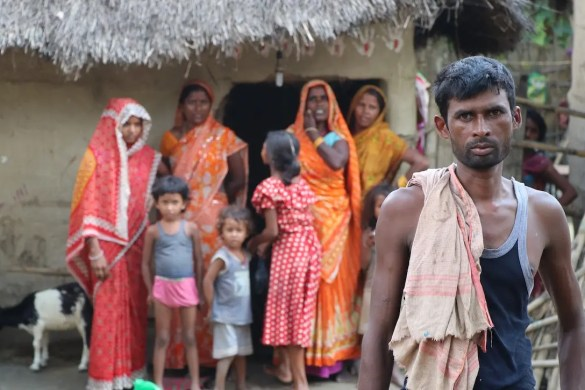 An image shows a poor Indian family in their village. This picture is used in Balanced Achievement's article on the untouchables of India.