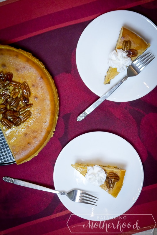pumpkin cheesecake with gingersnap crust, topped with candied pecans. Perfect for Thanksgiving dessert!