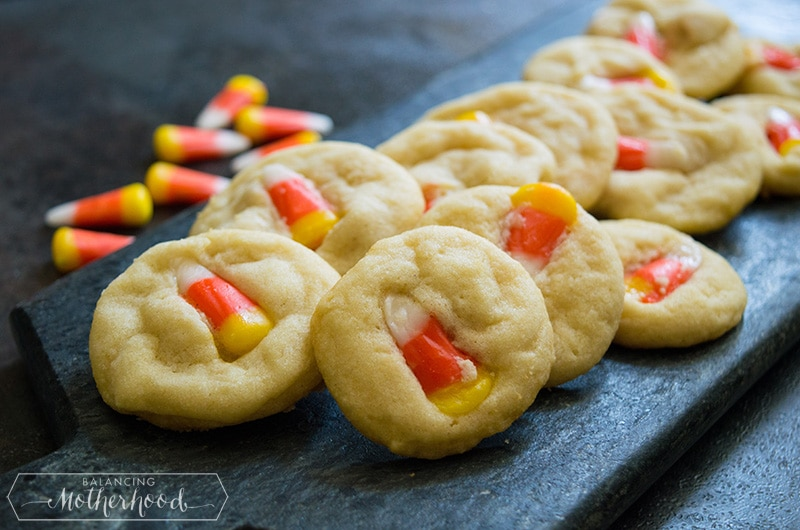 Halloween cookies on tray with candy corns