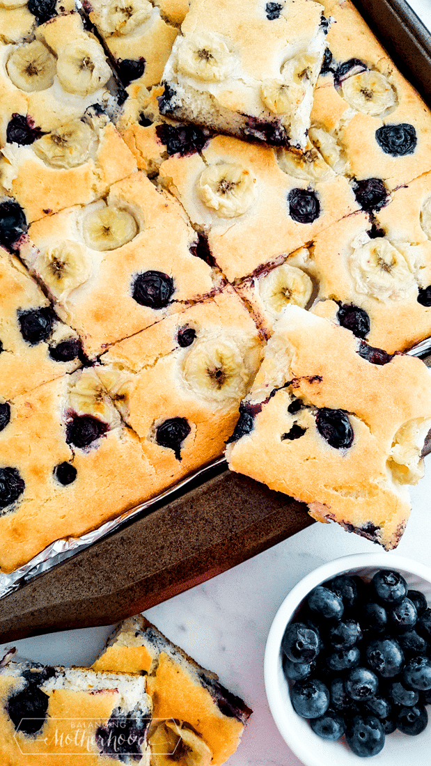 baked pancakes on sheet pan with side of blueberries
