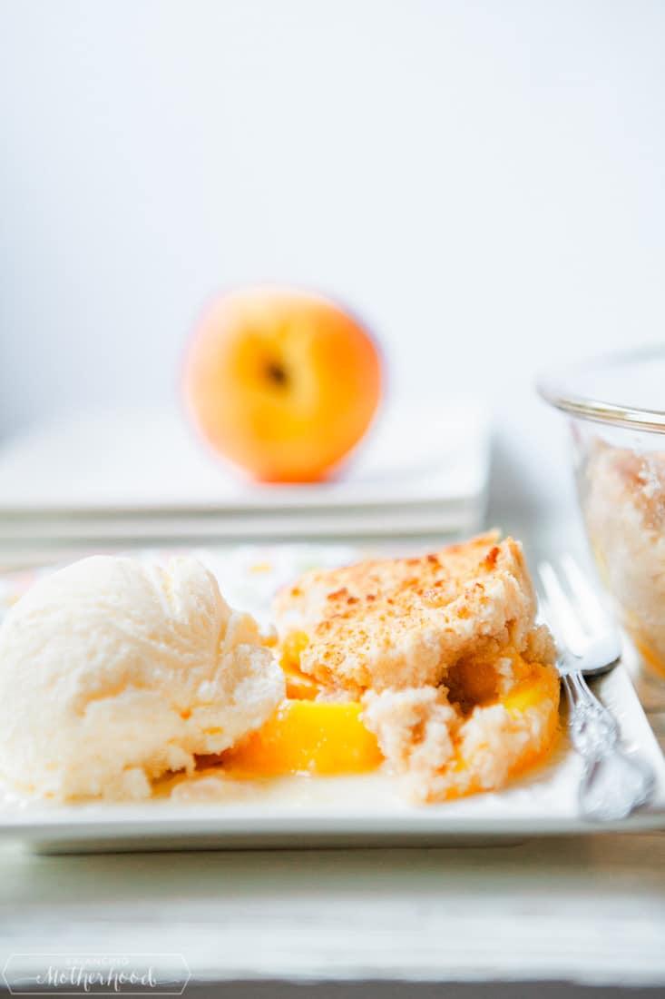 fresh peaches with peach cobbler and vanilla ice cream