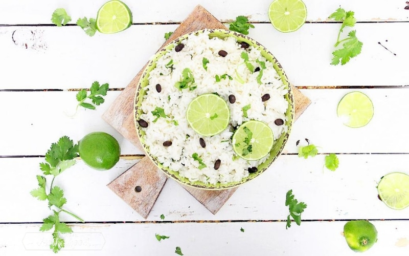 bowl with jasmine rice and limes on cutting board