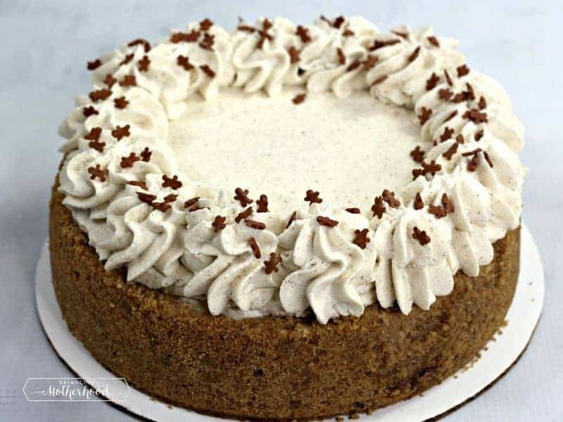 gingerbread cheesecake with piped frosting and mini gingerbread sprinkles