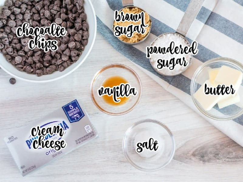 chocolate chips, brown sugar, powdered sugar, butter, vanilla, salt, and cream cheese on board