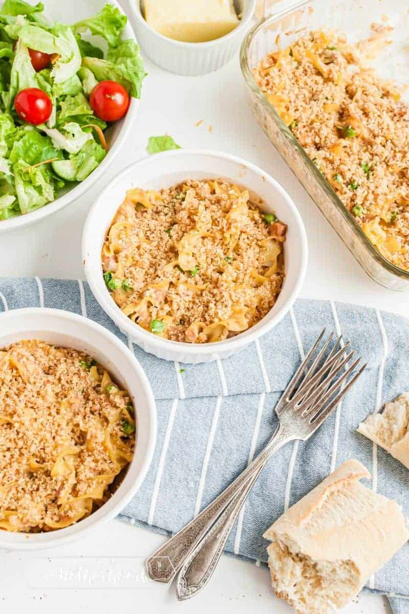 two bowls of tuna casserole with salad