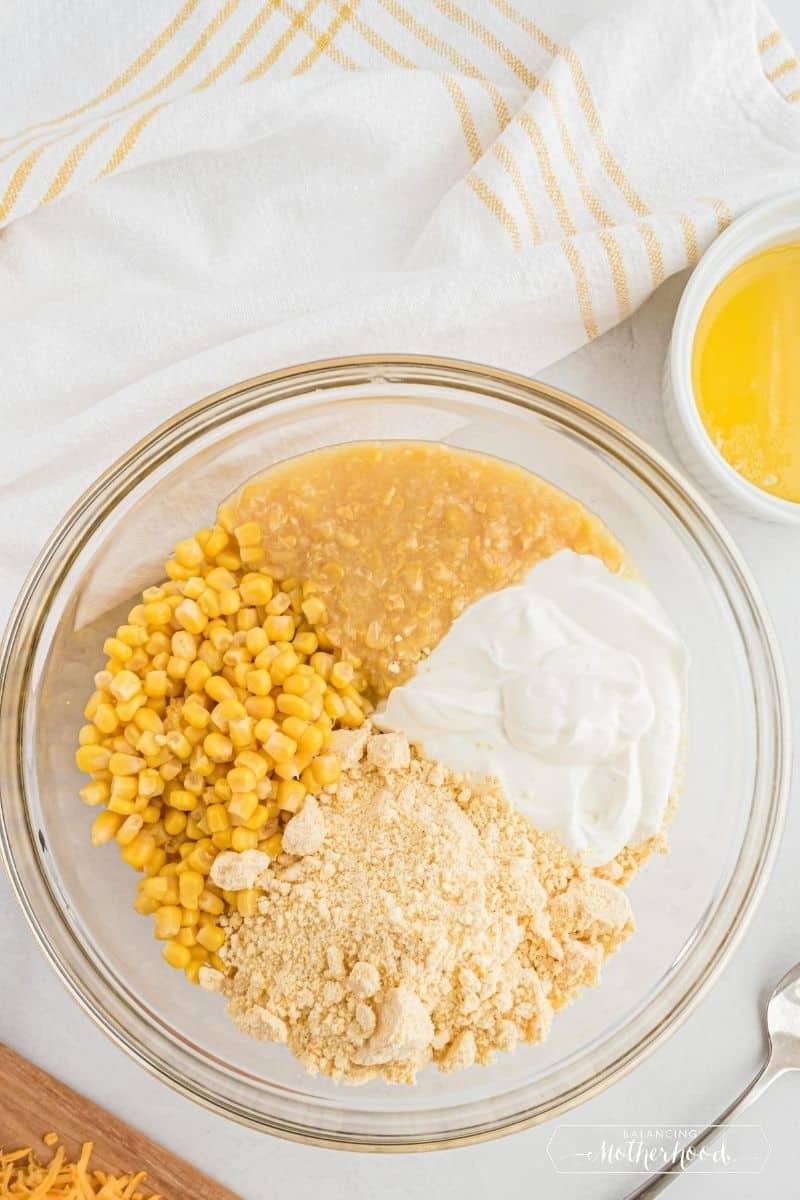 Bowl with corn, cream of corn, sour cream, and cornbread mix.