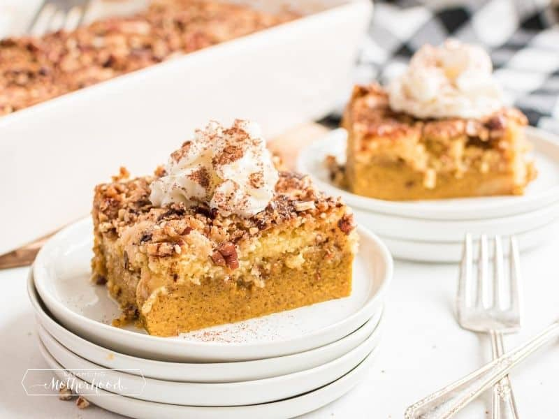 slice of pumpkin dump cake with whipped cream on top