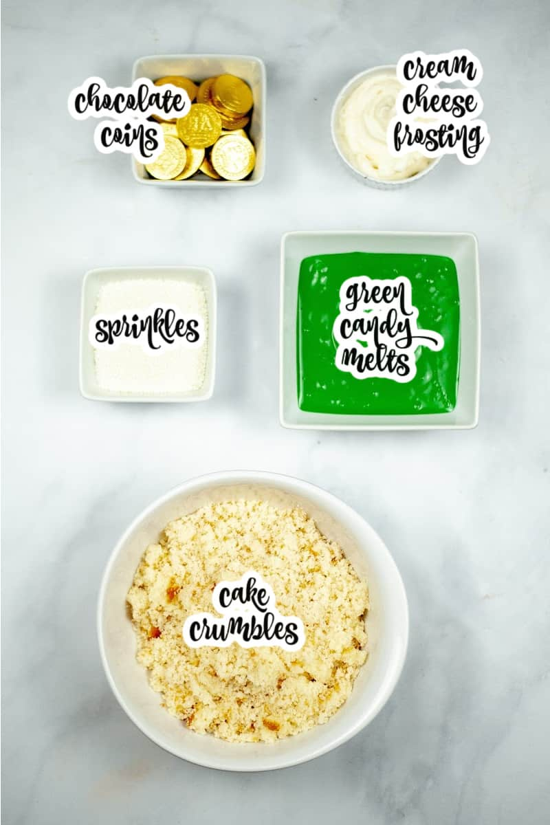 cake pop ingredients: cake crumbles, cream cheese frosting, sprinkles, green candy melts, chocolate coins