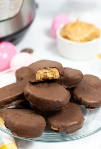 peanut butter eggs stacked on clear plate