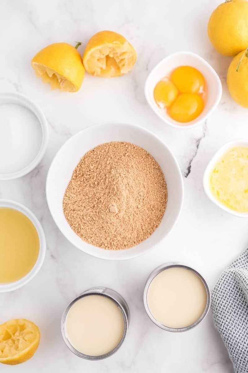 ingredients: graham cracker crumbs, lemons, sweetened condensed milk, eggs, melted butter