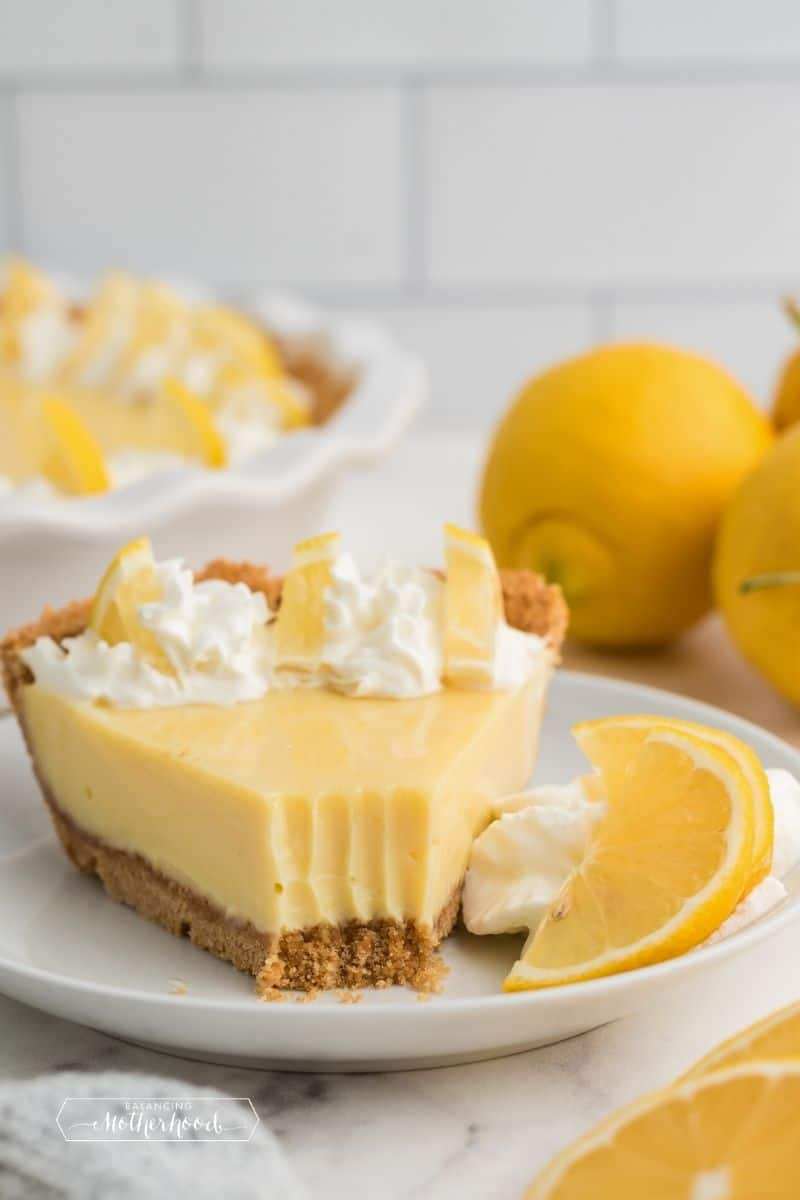 slice of lemon pie with bite out of the tip