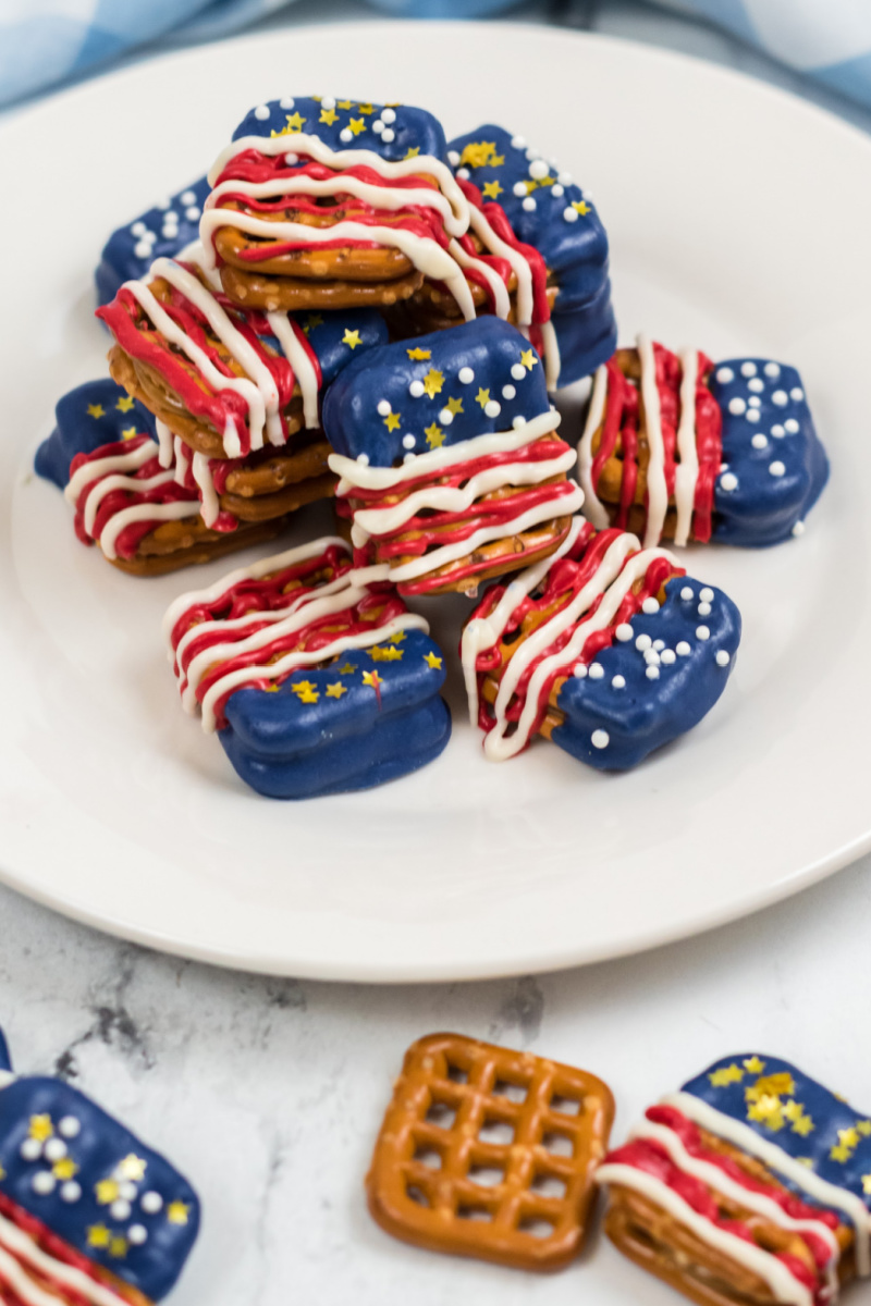 red, white and blue pretzel sandwiches on a white plate