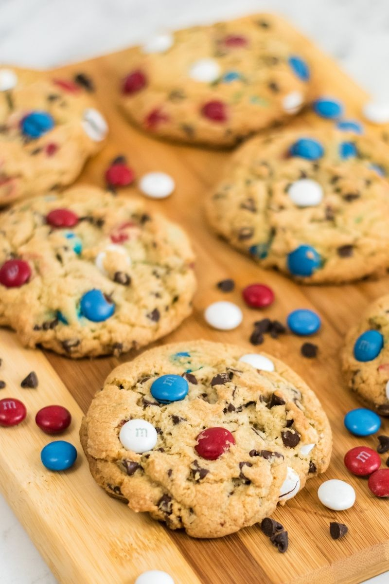 large cookies on cutting board with red, white, and blue M&Ms