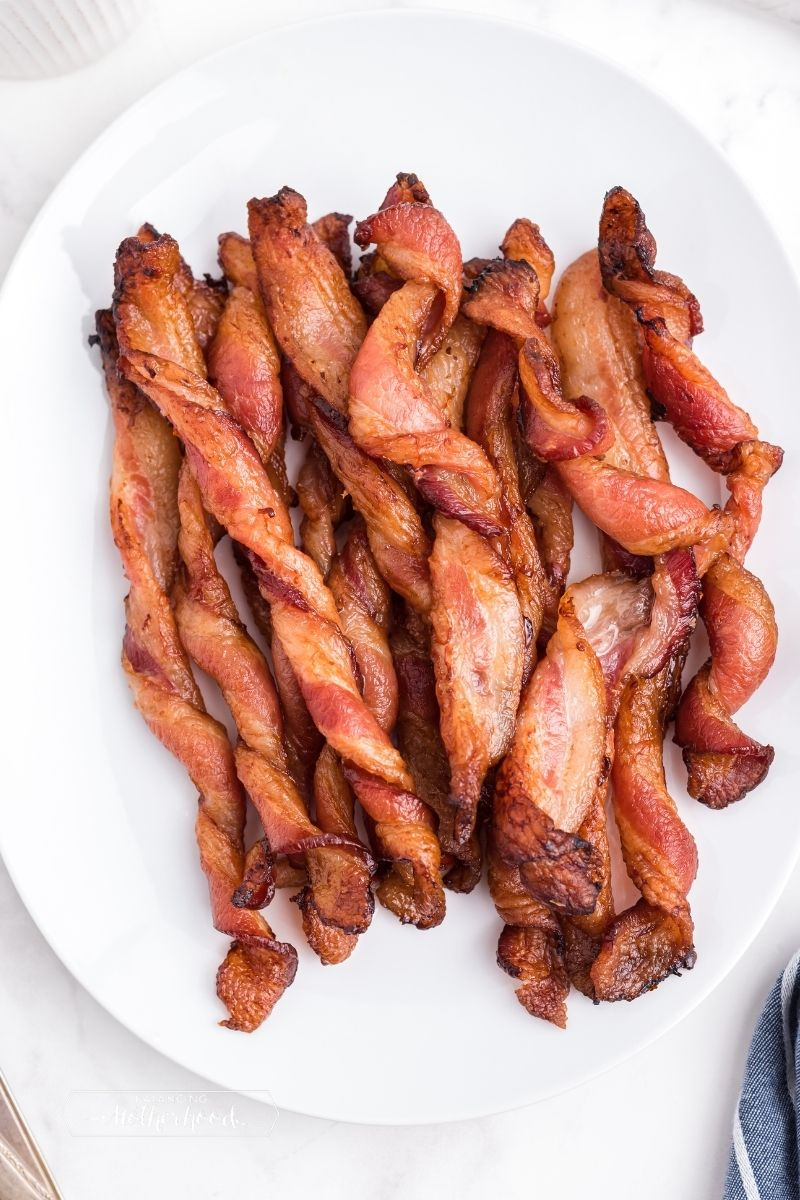 twisted bacon on white plate
