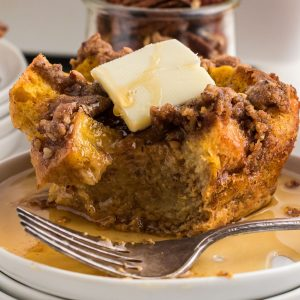 slice of pumpkin french toast casserole with butter