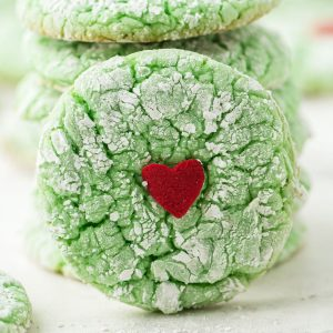 green crinkle cookie with red heart in the middle