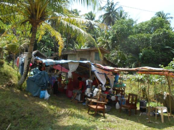 Those with damaged houses settle in makeshift tents.