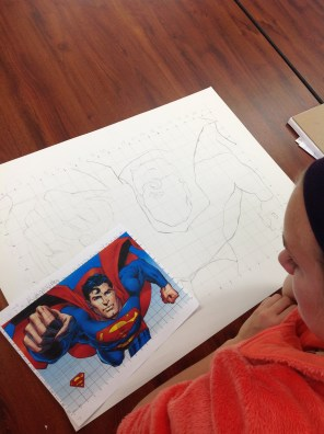 Kaleigh adding detail to her forced perspective grid drawing