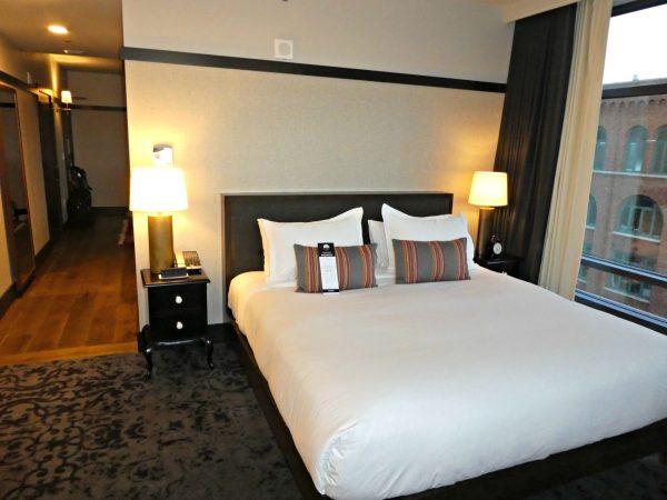 Kimpton Journeyman Suite Upgrade bed and hallway