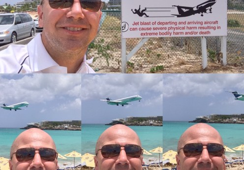 St Maartan Maho Beach airplane landing warning sign