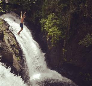 jumping-style-at-kroya-waterfalls-sambangan-trekking-with-local-guide