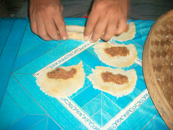 A sweet filling is placed on the thin dough before it is rolled
