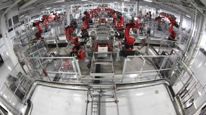 Tesla Motors Assembly Line by Steve Jurvetson (CC-BY 2.0) via Flickr (http://bit.ly/1Pubty6)