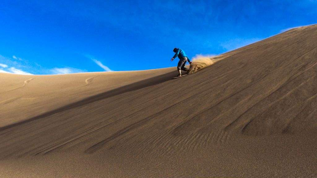 Sand boarding in Colorado at the highest sand dunes in North