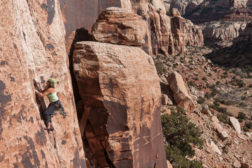female rock climber indian creek southeast utah