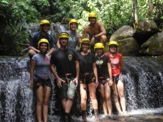 Happy landing after six waterfalls. Canyoning in Uvita.