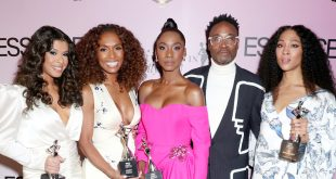 Pose Honored for Essence