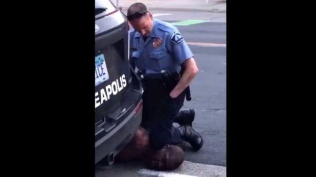 Police Officer Kneeling On Neck
