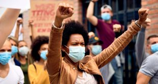 black woman wearing mask
