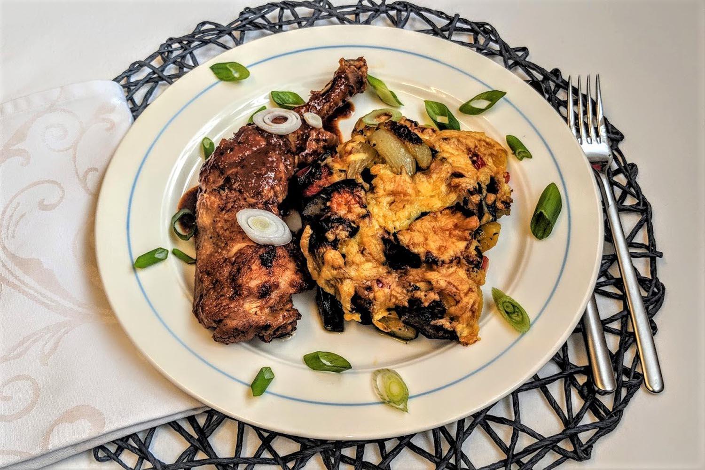 Geschmackvoller Gemüseauflauf mit geschmorten Hähnchenschenkeln Rezept