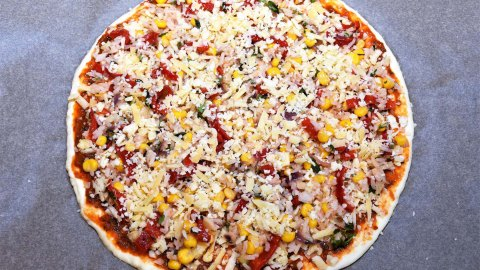 Pizza mit Reis Belag