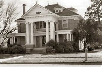 """Giescke - Sykes Home: This classic """"revival style"""" structure is located at 609 8th Street. Built in 1910 by rancher/banker Herman Giescke, this home has been well cared for b each of its owners. The home is currently owned by Mr. and Mrs. Bill Sykes."""