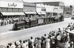 Parade in the 1960's. Model Santa Fe Train.