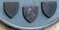 Armorial shields of Glasgow University, Snell and Balliol College, on a plaque re the building of the Snell Bridge building. (garden quad, north end, near Hall steps)