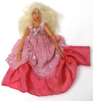 Lulabelle is a ball joint doll made of polymer clay