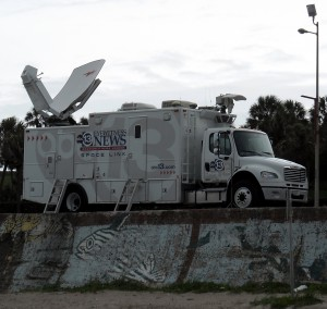 Like moths to the flame news vans like this one on the Seawall in Galveston become a familiar sight before and after the arrival of a hurricane. Photo R. Anderson