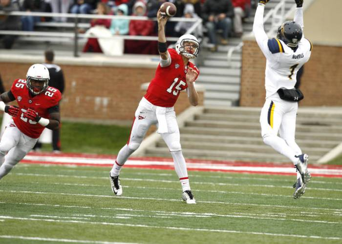 Riley Neal throws over the top of Toledo's defense