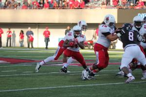 Running Back James Gilbert receives hand off from Riley Neal
