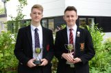 Ballyclre High School Best Senior Cricketers Rory Dorman and Ben Lowry with new Awards the Trevor Martin and JohnThompson trophies